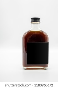Cold Brew Coffee in glass bottle with black cap isolated on white background
