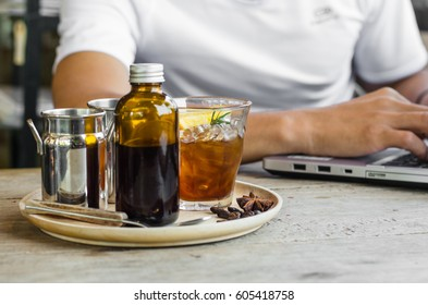 Cold Brew Coffee on wooden with man working background