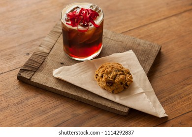 Cold brew coffee with rosewater and an oatmeal rasin cookie