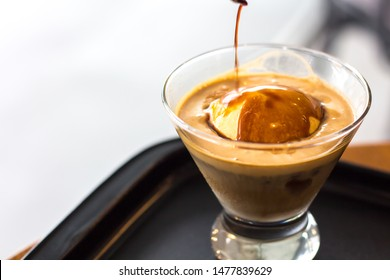 Cold Brew Iced Coffee Affogato, Vanilla Ice-Cream in a glass on wooden table background with copy space.