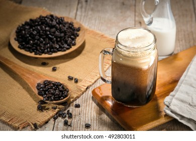 Cold brew iced coffee nitro tap poor in a jar artisan craft gourmet java stylish rustic