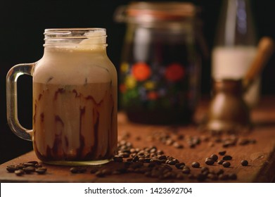 Cold brewed coffee frappe with chocolate sauce and ice cream, rustic look with copy space