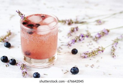 Cold carbonated lemonade (soda) with blueberries and lavender syrup. Soft focus. Place for text. Copy Space