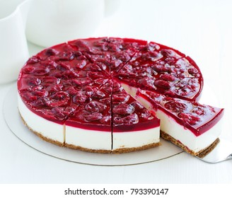 Cold cheesecake with cherry jelly.