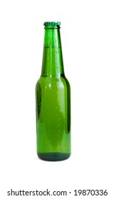 Cold chilled beer in green bottle on white background