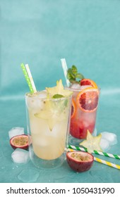 Cold cocktail with fresh starfruit and passionfruit
