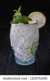 Cold cocktail with vodka and tonic in skull cup