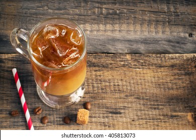 Cold coffee drink in glass, copy space