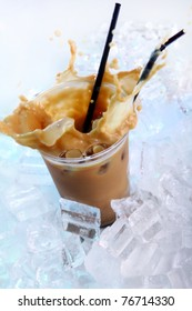 Cold coffee drink wwith ice and splashes