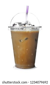 Cold coffee with ice cubes and straw in wet plastic cup on white background