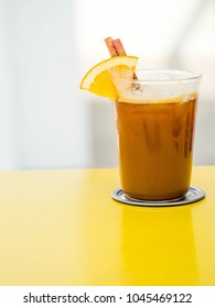 Cold coffee mix with orange juice and soda white background