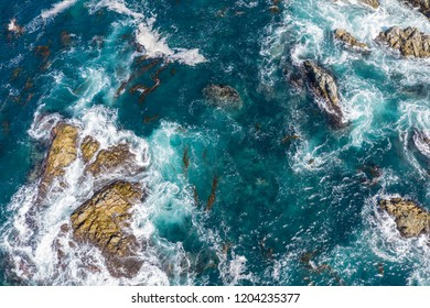 The cold, colorful waters of the North Pacific Ocean, wash against the rocky and scenic coastline of Northern California not far from Monterey. Kelp forests thrive in this coastal environment.