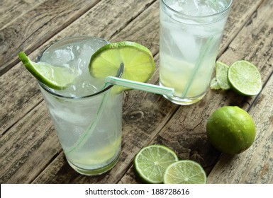 Cold drink with fresh lime and ice
