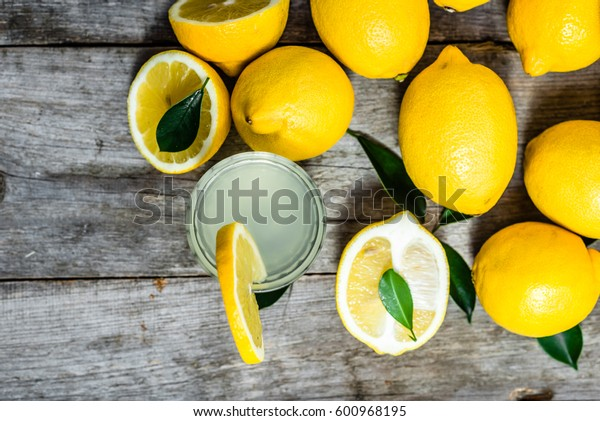 Cold drink - water with lemon juice in glass, top view