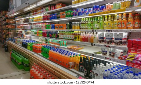 Cold drinks, juices, water, soda etc from popular FMCG brands displayed on a refrigerated aisle in a modern grocery outlet at a mall, Delhi, India 2019