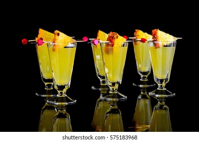 cold drinks with pineapple on black background