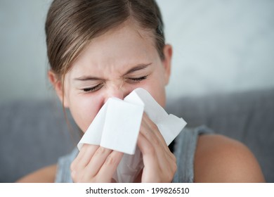 Cold flu illness of child - tissue blowing runny nose