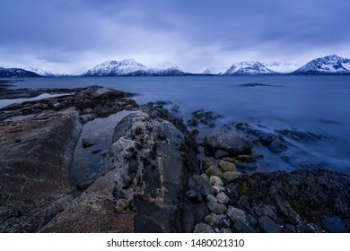 Cold and freezing temperatures on the coast of Lofotten, Norway. Pure natural beauty yet harsh conditions. Rocky seaside, moody skies.