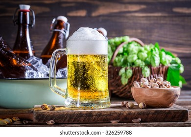 Cold and fresh beer with nuts