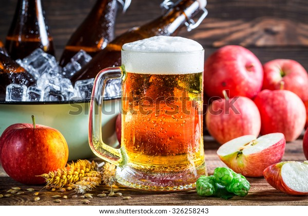 Cold and fresh cider beer with apples