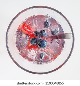 Cold fresh drink with fruits and ice. Summer refreshment. Water in glass.