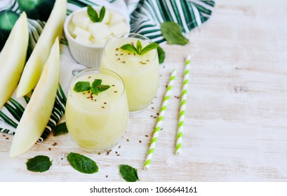 Cold fresh melon smoothies with mint in glass, summer drink beverage, healthy food concept, freshness, exotic fruits
