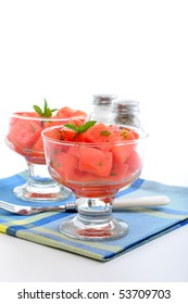 Cold fruit salad of fresh watermelon and mint.