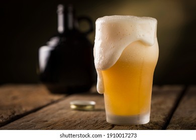 Cold glass filled with beer.