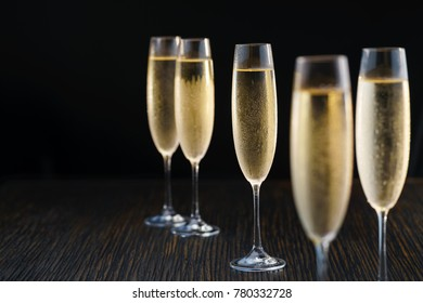 Cold glasses of champagne on black background.Selective focus.