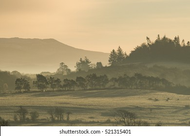 Cold hazy frosty winter morning sunrise landscape in County Kerry, Ireland