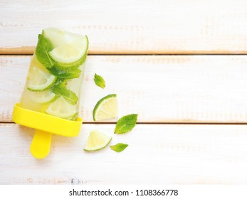 Cold homemade ice cream (sorbet) with lime, lemon, mint leaves. Summer food background