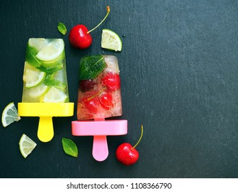 Cold homemade ice cream (sorbet) with lime, lemon, cherry and mint leaves. Summer food background