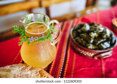 Cold homemade lemonade with decoration on a traditional bulgarian table. Special occasion table set up.
