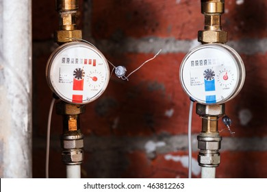 cold and hot residential water meters on pipes