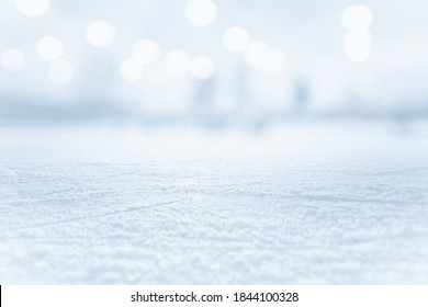 COLD ICE BACKROUND WITH SNOW AND BOKEH LIGHTS, WINTER BACKDROP