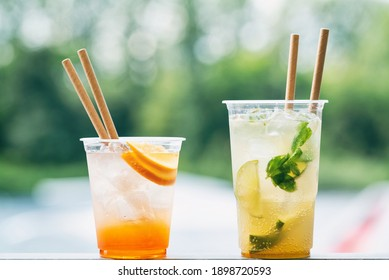 Cold ice beverage alcohol drink with fruits. Drikk with lemon,orange and ice. Water background.