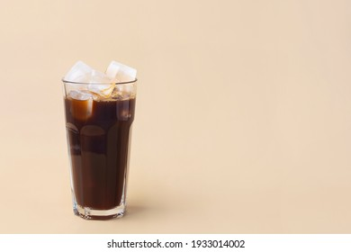 cold iced coffee on a beige background, minimalism, summer drink