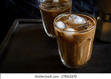 Cold Iced Coffee put on old wooden