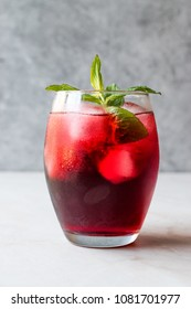 Cold Iced Tea Hibiscus with ice and Mint Leaves.