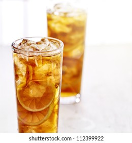 cold iced tea with sliced lemons.