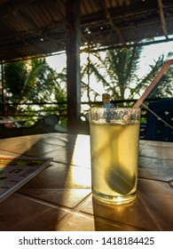 Cold juice served outside in an Indian beach cafe in Gokarna,wth a sprinkle of sugar and spoon to stir.