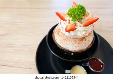 Cold Korean ice cream put strawberry Bingsoo or Bingsu on a white background.