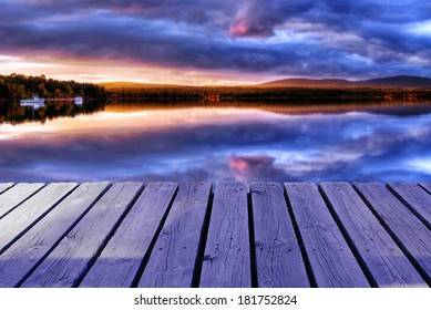 Cold lake with clouds wooden dock