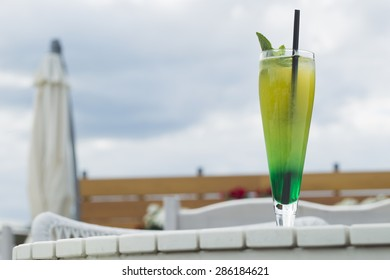 The cold lemonade with mint and ice on the outdoor veranda summer day, sunlit.