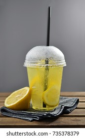 Cold lemonade on wooden table