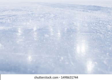 COLD LIGHT BACKGROUND, CLOSE OF ICE SURFACE WITH REFLECTED LIGHTS, ICE HOCKEY STADIUM