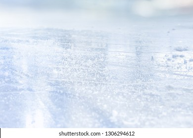 COLD LIGHT BACKGROUND, ICE HOCKEY STADIUM WITH SCRATCHED ICE SURFACE