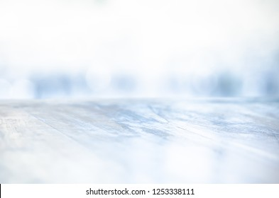 COLD LIGHT BACKGROUND WITH OLD WOODEN ICY SURFACE