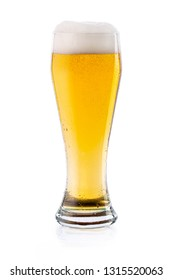 Cold light lager beer with drops and foam in glass. isolated