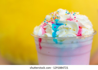 cold lollipop  milkshake drink with whip cream and colorful sugar balls
